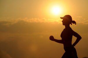 Woman with sun visor running